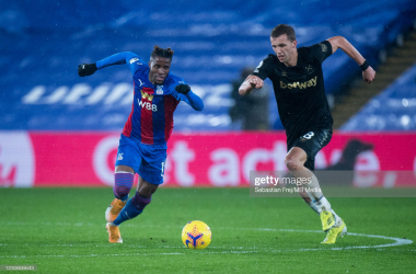 LONDON, ENGLAND - JANUARY 26: Wilfried Zaha of Crystal Palace and Tomas Soucek of West Ham United in action during the Premier League match between Crystal Palace and West Ham United at Selhurst Park on January 26, 2021 in London, United Kingdom. Sporting stadiums around the UK remain under strict restrictions due to the Coronavirus Pandemic as Government social distancing laws prohibit fans inside venues resulting in games being played behind closed doors. (Photo by Sebastian Frej/MB Media/Getty Images)