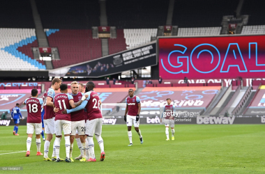 LONDON, ENGLAND - APRIL 11: Jarrod Bowen of West Ham United celebrates with Jesse Lingard and Arthur Masuaku after scoring their side's third goal during the Premier League match between West Ham United and Leicester City at London Stadium on April 11, 2021 in London, England. Sporting stadiums around the UK remain under strict restrictions due to the Coronavirus Pandemic as Government social distancing laws prohibit fans inside venues resulting in games being played behind closed doors. (Photo by Justin Setterfield/Getty Images)