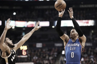 Russell Westbrook takes a jump shot over Cory Joseph Thursday night. PHOTO: Tom Szczerbowski-USA Today Sports