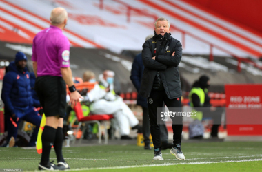 SHEFFIELD, ENGLAND - JANUARY 17: Chris Wilder, Manager of Sheffield United talks to assistant referee Richard West during the Premier League match between Sheffield United and Tottenham Hotspur at Bramall Lane on January 17, 2021 in Sheffield, England. Sporting stadiums around England remain under strict restrictions due to the Coronavirus Pandemic as Government social distancing laws prohibit fans inside venues resulting in games being played behind closed doors. (Photo by Mike Egerton - Pool/Getty Images)