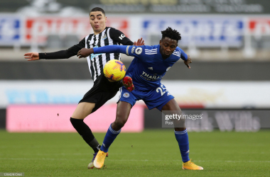 NEWCASTLE UPON TYNE, ENGLAND - JANUARY 03: Wilfred Ndidi of Leicester City (R) is tackled by Miguel Almiron of Newcastle United (L) during the Premier League match between Newcastle United and Leicester City at St. James Park on January 03, 2021 in Newcastle upon Tyne, England. The match will be played without fans, behind closed doors as a Covid-19 precaution. (Photo by Lee Smith - Pool/Getty Images)