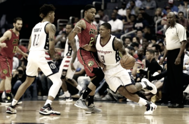 Washington Wizards guard Bradley Beal (3) dribbles the ball against Atlanta Hawks forward Kent Bazemore (24). Photo: Geoff Burke-USA TODAY Sports