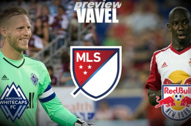 Vancouver Whitecaps goalkeeper David Ousted (left, in green) will look to prevent New York Red Bulls forward Bradley Wright-Phillips (in white, right) from scoring on Saturday.