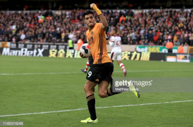 <div>WOLVERHAMPTON, ENGLAND - OCTOBER 19: Raul Jimenez of Wolverhampton Wanderers celebrates after scoring his team's first goal during the Premier League match between Wolverhampton Wanderers and Southampton FC at Molineux on October 19, 2019 in Wolverhampton, United Kingdom. (Photo by Matthew Lewis/Getty Images)</div>