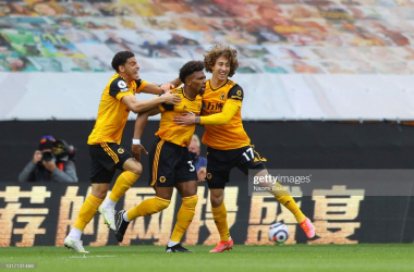 WOLVERHAMPTON, ENGLAND - MAY 09: Pascal Estrada of Wolverhampton Wanderers celebrates with Morgan Gibbs-White of Wolverhampton Wanderers and Fabio Silva of Wolverhampton Wanderers after scoring his sides first goal during the Premier League match between Wolverhampton Wanderers and Brighton & Hove Albion at Molineux on May 09, 2021 in Wolverhampton, England. Sporting stadiums around the UK remain under strict restrictions due to the Coronavirus Pandemic as Government social distancing laws prohibit fans inside venues resulting in games being played behind closed doors. (Photo by Naomi Baker/Getty Images)