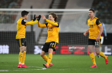 WOLVERHAMPTON, ENGLAND - APRIL 05: Fabio Silva of Wolverhampton Wanderers (C) celebrates with teammates Pedro Neto and Leander Dendoncker of Wolverhampton Wanderers after scoring their team's second goal during the Premier League match between Wolverhampton Wanderers and West Ham United at Molineux on April 05, 2021 in Wolverhampton, England. Sporting stadiums around the UK remain under strict restrictions due to the Coronavirus Pandemic as Government social distancing laws prohibit fans inside venues resulting in games being played behind closed doors. (Photo by Nick Potts - Pool/Getty Images)