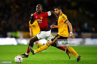 Ruben Neves of Wolverhampton Wanderers in action with Paul Pogba of Manchester United during the match between Wolverhampton Wanderers and Manchester United at Molineux on March 16, 2019 in Wolverhampton, England. (Photo by Chris Brunskill/Fantasista/Getty Images)