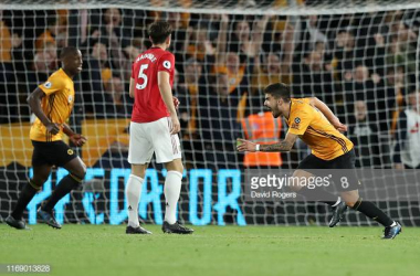 <div>WOLVERHAMPTON, ENGLAND - AUGUST 19: Ruben Neves of Wolverhampton Wanderers celebrates after scoring his team's first goal during the Premier League match between Wolverhampton Wanderers and Manchester United at Molineux on August 19, 2019 in Wolverhampton, United Kingdom. (Photo by David Rogers/Getty Images)</div>