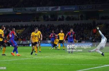 Jordan Ayew scores his team's first goal during the Premier League match between Wolverhampton Wanderers and Crystal Palace at Molineux. (Photo by Matthew Lewis/Getty Images)