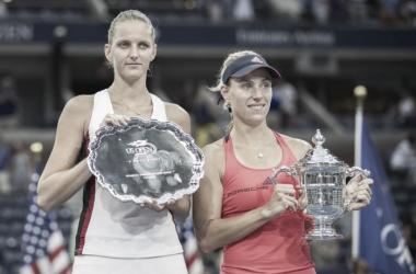 Angelique Kerber (right) and Karolina Pliskova hold their US Open trophies. Photo: Susan Mullane/USA Today