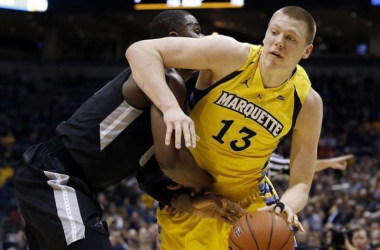 Ben Bentil and Henry Ellenson, the two stars of Wednesday's tussle, battle in the paint. (Photo credit: AP)