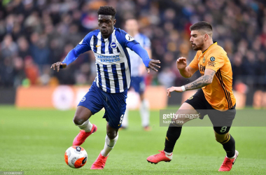 Ruben Neves chases after Yves Bissouma during Brighton's last visit to Molineux in March 2020. (Photo by Nathan Stirk/Getty Images)
