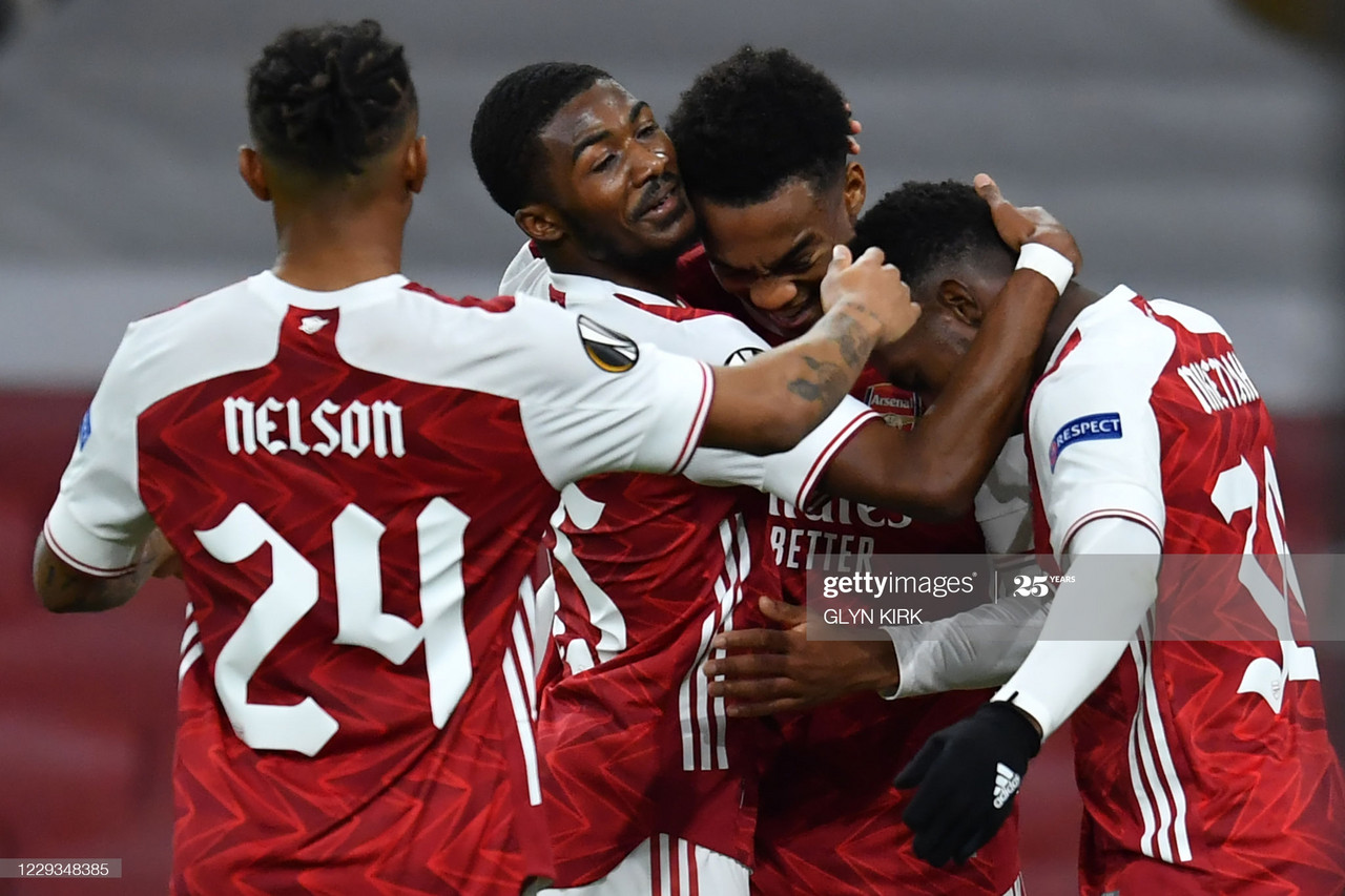 Arsenal's English midfielder Joe Willock (2R) celebrates with teammates after he scores his team's second goal during the UEFA Europa League 1st round day 2 Group B football match between Arsenal and Dundalk at the Emirates Stadium in London on October 29, 2020. (Photo by Glyn KIRK / AFP) (Photo by GLYN KIRK/AFP via Getty Images)