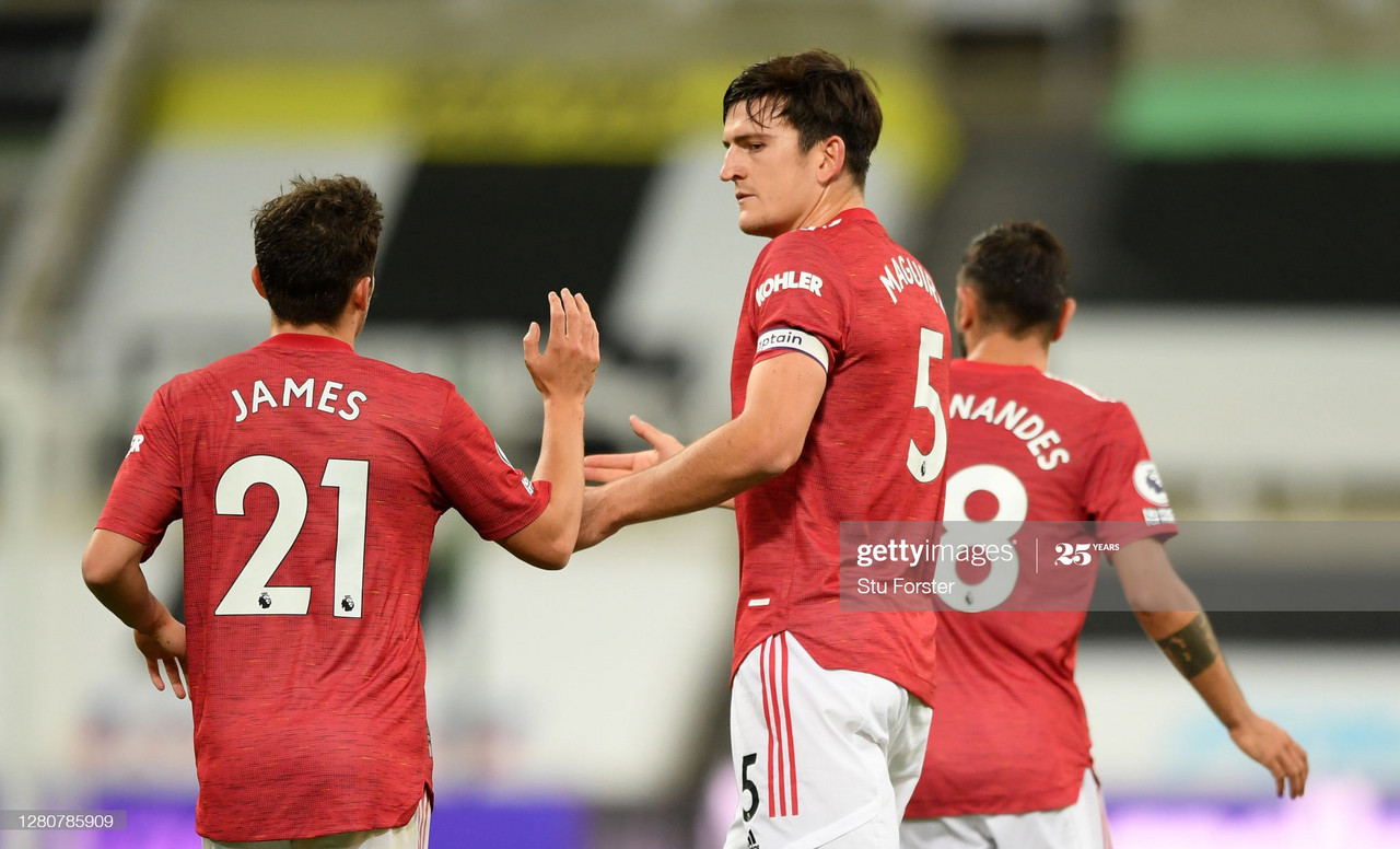 NEWCASTLE UPON TYNE, ENGLAND - OCTOBER 17: Harry Maguire of Manchester United celebrates with Daniel James of Manchester United after scoring his team's first goal during the Premier League match between Newcastle United and Manchester United at St. James Park on October 17, 2020 in Newcastle upon Tyne, England. Sporting stadiums around the UK remain under strict restrictions due to the Coronavirus Pandemic as Government social distancing laws prohibit fans inside venues resulting in games being played behind closed doors. (Photo by Stu Forster/Getty Images)