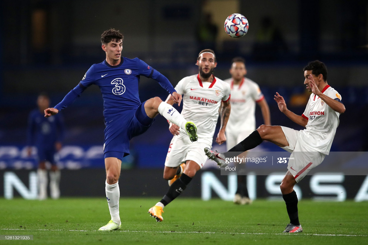 Kai Havertz of Chelsea is challenged by Jesus Navas of FC Sevilla during the UEFA Champions League Group E stage match between Chelsea FC and FC Sevilla at Stamford Bridge on October 20, 2020 in London, England. (Photo by Adam Davy - Pool/Getty Images)