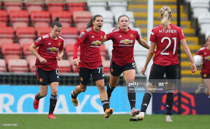 <div>LEIGH, ENGLAND - NOVEMBER 14: Tobin Heath of Manchester United Women celebrates after scoring her goal during the Barclays FA Women's Super League match between Manchester United Women and Manchester City Women at Leigh Sports Village on November 14, 2020 in Leigh, England. (Photo by Alex Livesey - Danehouse/Getty Images)</div>