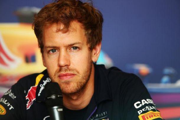 Vettel Takes Ferrari Seat For 2015