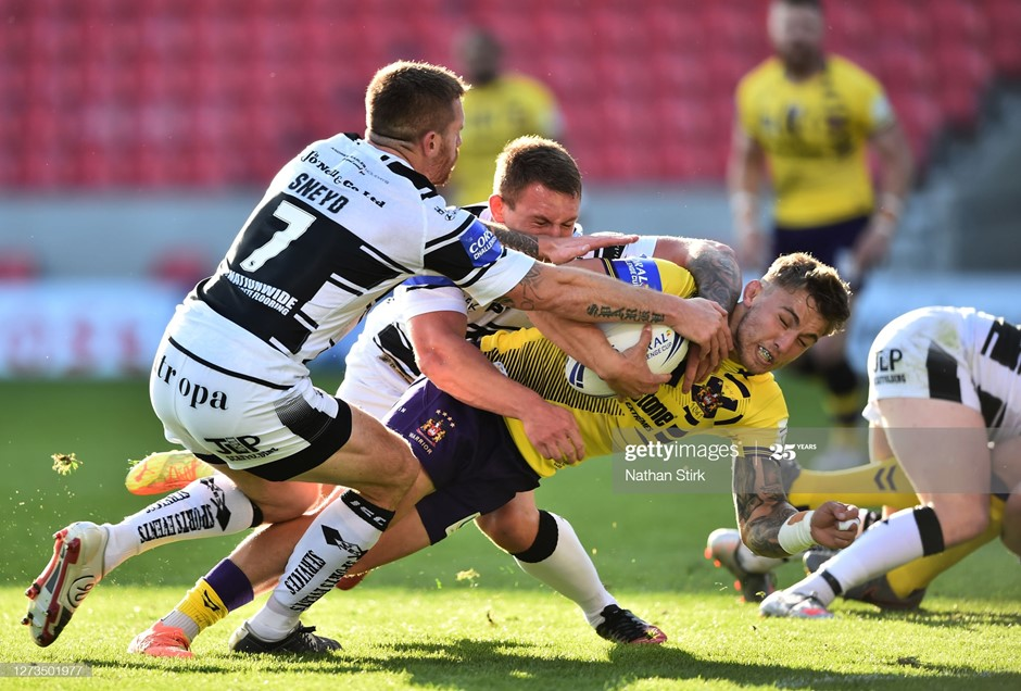 Wigan's Sam Powell gets over the line for the first try of the match against Hull. Photo: Nathan Stirk/Getty Images.