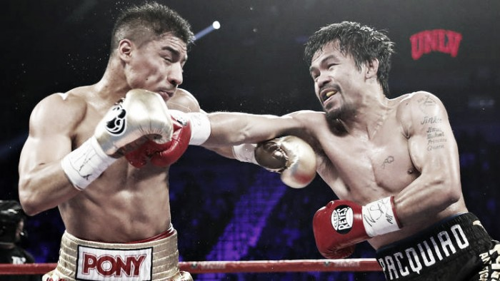 Jessie Vargas and Manny Pacquiao trade blows at the Thomas & Mack Center.  Photo Credit: Isaac Brekin, Associated Press