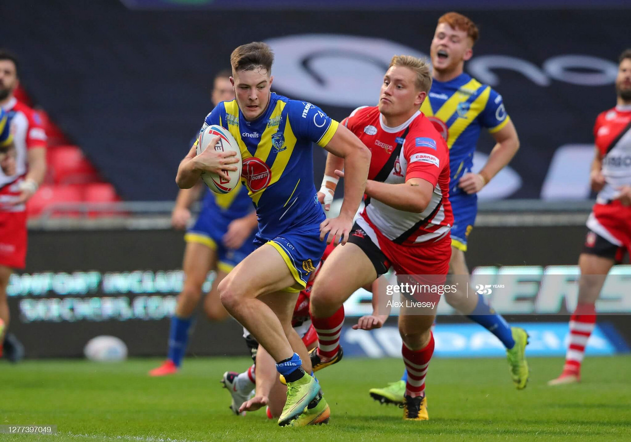 <div>SALFORD, ENGLAND - SEPTEMBER 29: Riley Dean of Warrington Wolves beats James Greenwood of Salford Red Devils on his way to scoring a try during the Betfred Super League match between Salford Red Devils of Warrington Wolves at AJ Bell Stadium on September 29, 2020 in Salford, England. Sporting stadiums around the UK remain under strict restrictions due to the Coronavirus Pandemic as Government social distancing laws prohibit fans inside venues resulting in games being played behind closed doors. (Photo by Alex Livesey/Getty Images)</div><div><br></div>