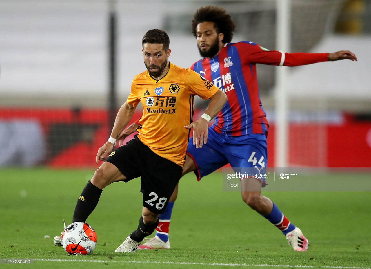Joao Moutinho shields the ball from Jairo Riedewald during Wolves' 2-0 win over Palace in July. (Photo by Martin Rickett/Pool Getty Images)