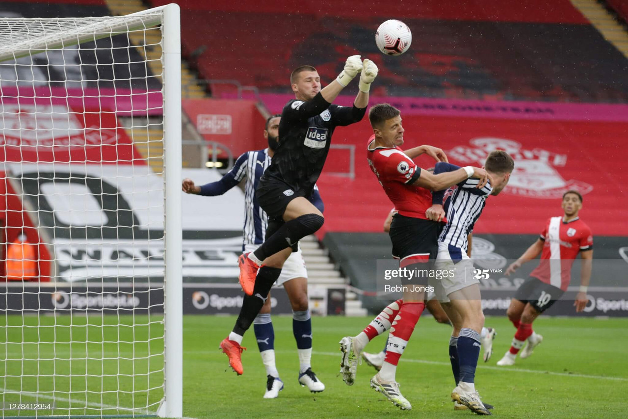 Sam Johnstone of West Bromwich Albion punches clear of Jan Bednarek of Southampton during the Premier League match between Southampton and West Bromwich Albion at St Mary's Stadium on October 04, 2020 in Southampton, England. Sporting stadiums around the UK remain under strict restrictions due to the Coronavirus Pandemic as Government social distancing laws prohibit fans inside venues resulting in games being played behind closed doors. (Photo by Robin Jones/Getty Images)
