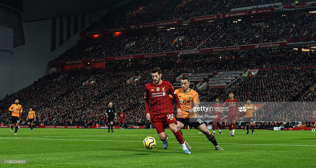 LIVERPOOL, ENGLAND - DECEMBER 29: (THE SUN OUT, THE SUN ON SUNDAY OUT) Adam Lallana of Liverpool competing with Diogo Jota of Wolverhampton Wanderers during the Premier League match between Liverpool FC and Wolverhampton Wanderers at Anfield on December 29, 2019 in Liverpool, United Kingdom. (Photo by John Powell/Liverpool FC via Getty Images)