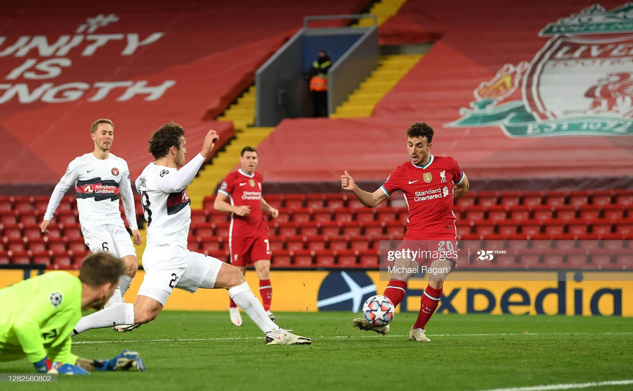 <div>Diogo Jota of Liverpool scores his team's first goal during the UEFA Champions League Group D stage match between Liverpool FC and FC Midtjylland at Anfield on October 27, 2020 in Liverpool, England. Sporting stadiums around the UK remain under strict restrictions due to the Coronavirus Pandemic as Government social distancing laws prohibit fans inside venues resulting in games being played behind closed doors. (Photo by Michael Regan/Getty Images)</div><div><br></div>