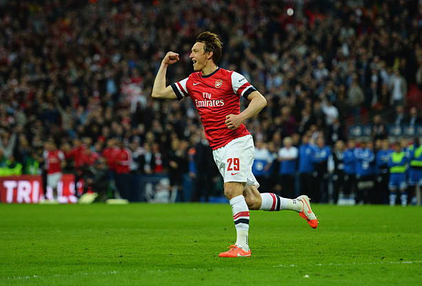 LONDON, ENGLAND - APRIL 12: Kim Kallstrom of Arsenal celebrates scoring in the penalty shoot during the FA Cup Semi-Final match between Wigan Athletic and Arsenal at Wembley Stadium on April 12, 2014 in London, England. (Photo by Shaun Botterill/Getty Images)