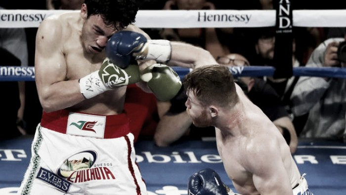 Canelo Alvarez lands a right hand against JulioCesar Chavez Jr. during their fight in Las Vegas. (Source: IsaacBrekken / Associated Press)