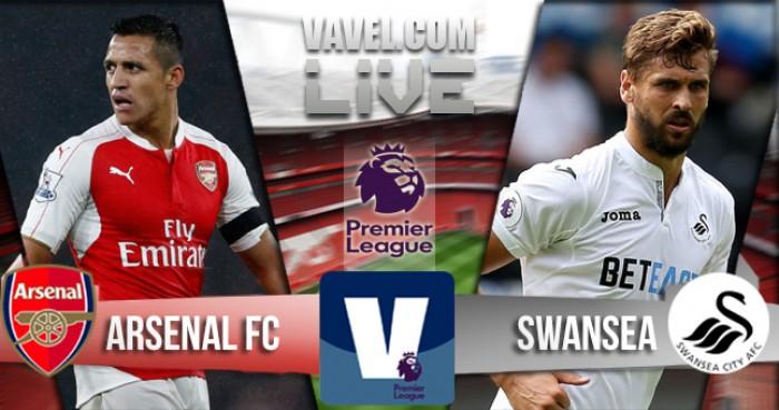 Walcott y Özil acercan al Arsenal a la cima de la clasificación