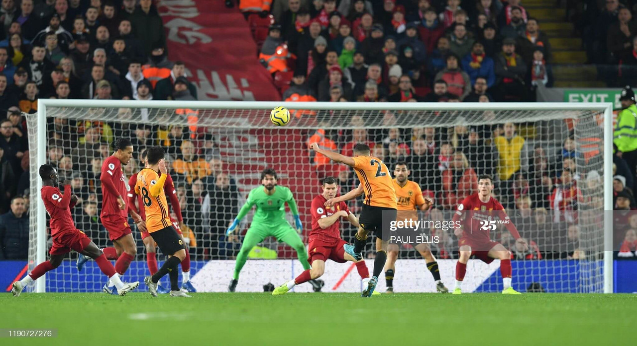 Romain Saiss sees his shot fly into the Anfield Road Stand during Wolves' last visit to Merseyside. (Photo by Getty Images/Paul Ellis)