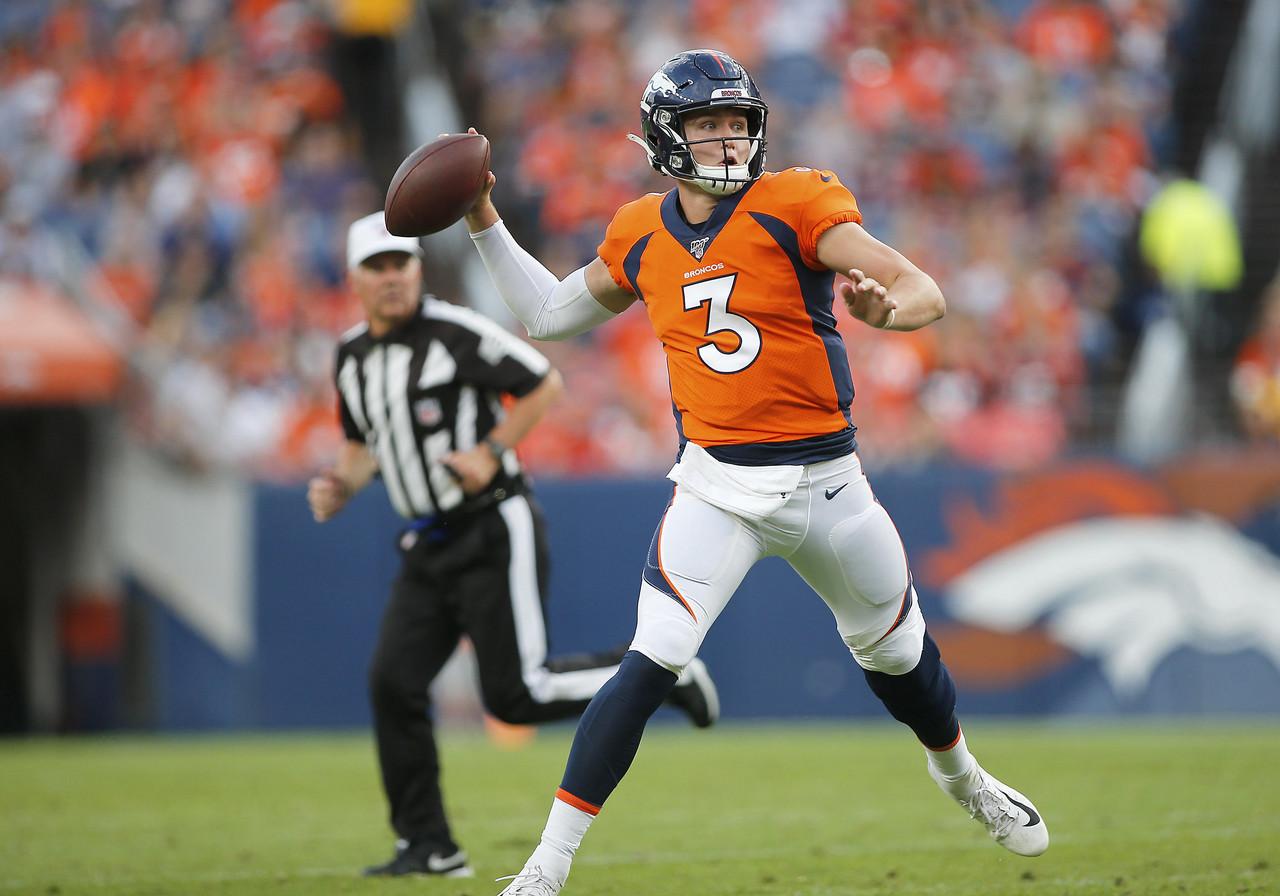 Denver Broncos back up quarterback Drew Lock with draft picks