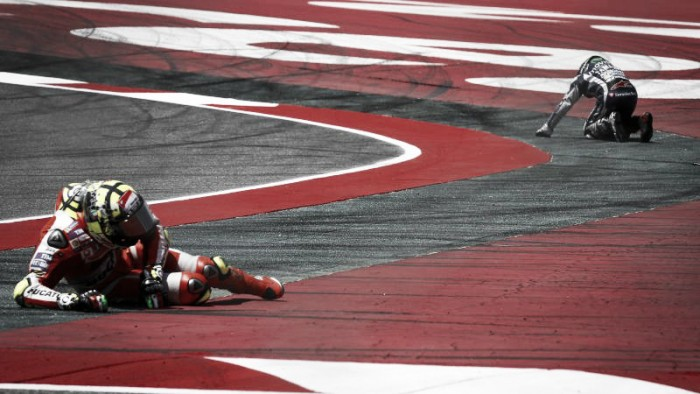 Andrea Iannone receives penalty after crash with Jorge Lorenzo