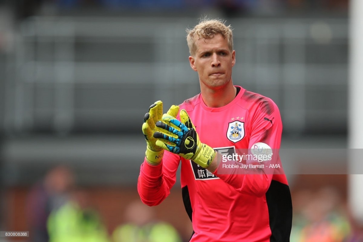 "Jonas Lössl: Huddersfield ""have to stay positive and believe"" ahead of difficult relegation run in"