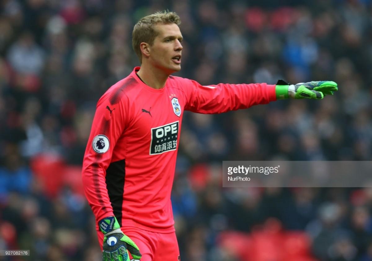 Huddersfield Town trigger clause to make Jonas Lössl signing permanent
