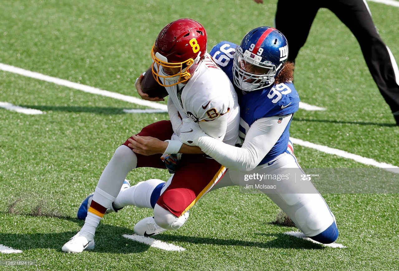 EAST RUTHERFORD, NEW JERSEY - OCTOBER 18: (NEW YORK DAILIES OUT) Leonard Williams #99 of the New York Giants in action against Kyle Allen #8 of the Washington Football Team at MetLife Stadium on October 18, 2020 in East Rutherford, New Jersey. The Giants defeated Washington 20-19. (Photo by Jim McIsaac/Getty Images)