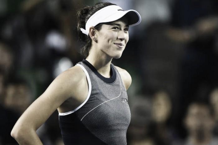 WTA Tokyo: Garbine Muguruza beats Monica Puig in first match as world number one