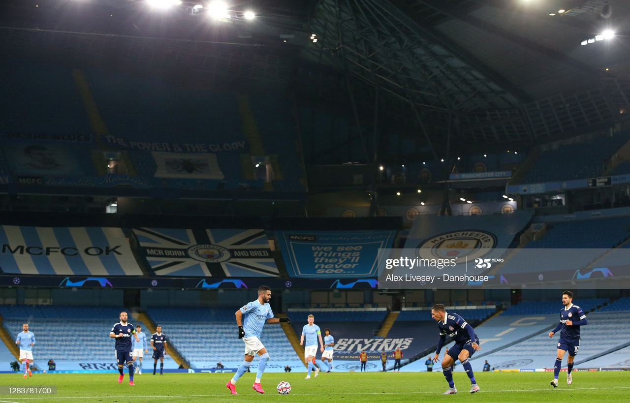 <div>MANCHESTER, ENGLAND - NOVEMBER 03: Riyad Mahrez of Manchester City runs at the Olympiacos defence during the UEFA Champions League Group C stage match between Manchester City and Olympiacos FC at Etihad Stadium on November 03, 2020 in Manchester, England. (Photo by Alex Livesey - Danehouse/Getty Images)</div><div><br></div>