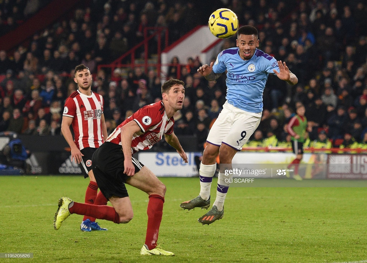 Manchester City's Brazilian striker Gabriel Jesus (R) heads towards goal but fails to score during the English Premier League football match between Sheffield United and Manchester City at Bramall Lane in Sheffield, northern England on January 21, 2020.