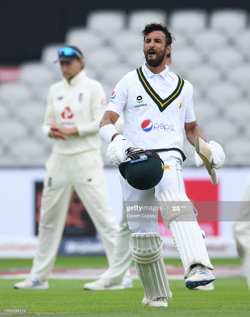 Shan Masood celebrates his century as Pakistan made 326 in their first innings