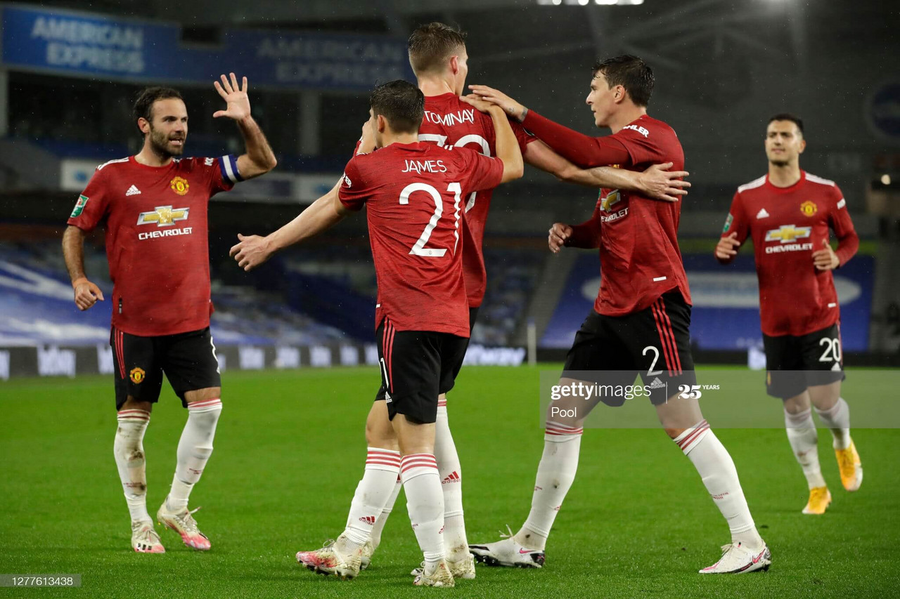 BRIGHTON, ENGLAND - SEPTEMBER 30: Scott McTominay of Manchester United celebrates with teammates after scoring his sides first goal during the Carabao Cup fourth round match between Brighton and Hove Albion and Manchester United at Amex Stadium on September 30, 2020 in Brighton, England. Football Stadiums around United Kingdom remain empty due to the Coronavirus Pandemic as Government social distancing laws prohibit fans inside venues resulting in fixtures being played behind closed doors. (Photo by Matt Dunham - Pool/Getty Images)