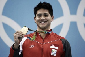 Rio 2016: Joseph Schooling schools rest of the field to capture gold in the men's 100m butterfly; Phelps, le Clos, Cseh in three-way tie for silver