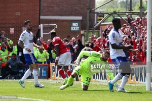 Nottingham Forest 3-0 Ipswich Town: Assombalonga brace helps Reds secure Championship survival
