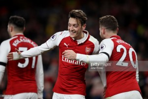 Arsenal 5-0 Huddersfield Town: Four minute Ozil masterclass sends the Gunners to victory