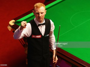 Anthony McGill and Judd Trump progress with rusty performances