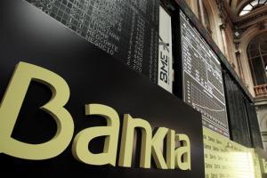 Las nuevas acciones de Bankia caen un 15 % en su primer día