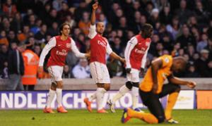 Gunners ease past sorry Wolves