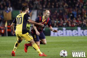 Iniesta y Turan, el fútbol en sus botas