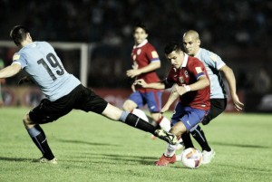 Arsenal in action: Alexis' struggles continue in Chile's 3-0 defeat at Uruguay